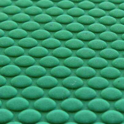 緑色のマットの表面をアップで撮影してあります